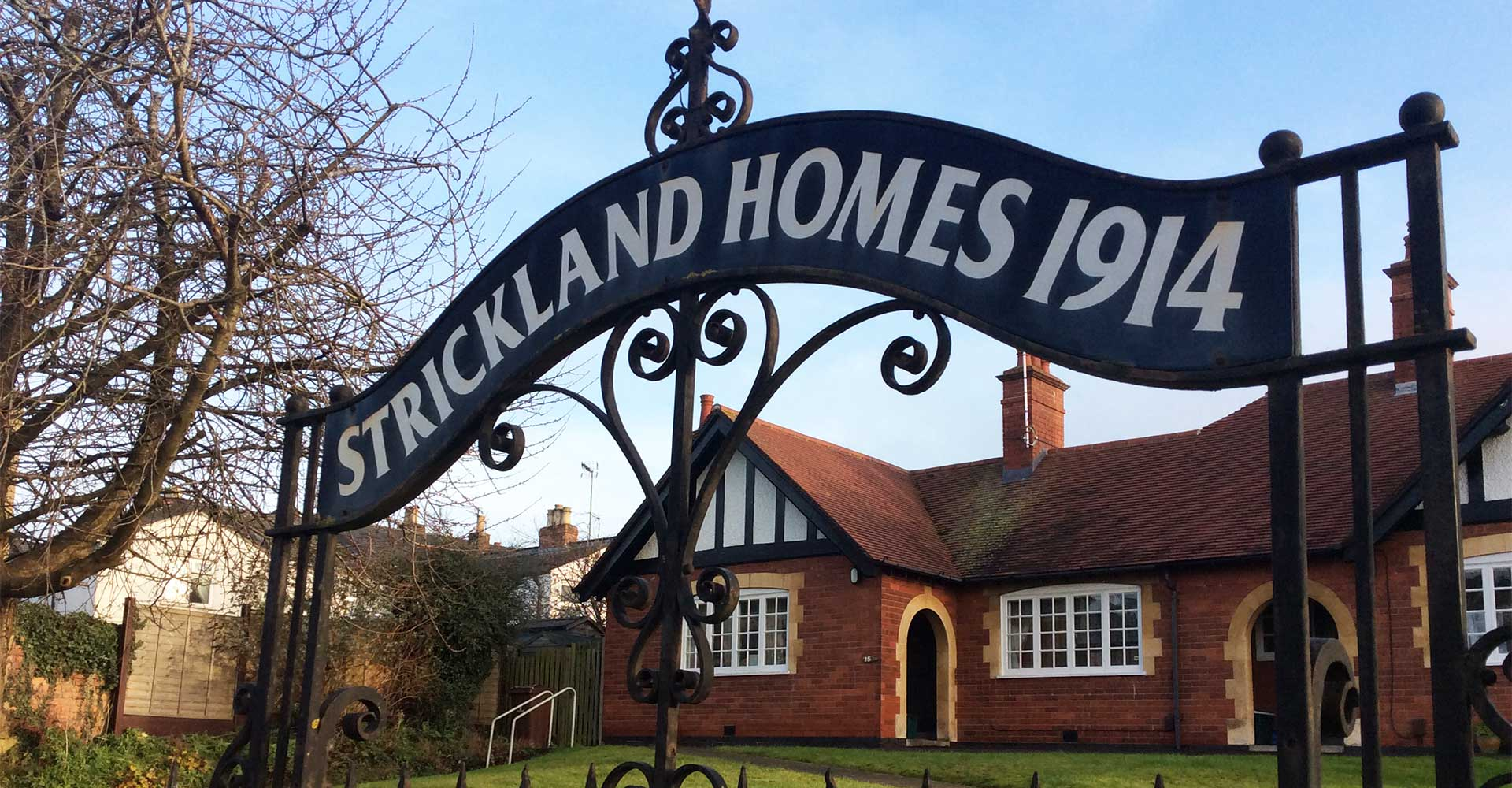 Strickland Homes Almshouses accommodation sign